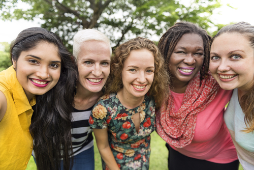 women-smiling-outdoors